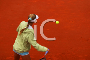 Royalty Free Photo of a Girl Playing Tennis