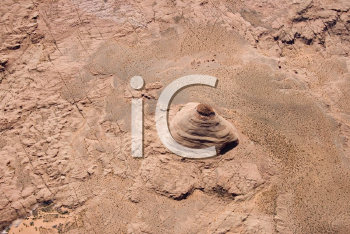 Royalty Free Photo of an Aerial of an Extruding Rock Formation in a Desert Landscape of Utah, USA