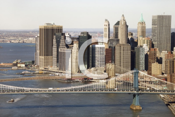 Royalty Free Photo of an Aerial view of New York City's Manhattan Bridge with Brooklyn Bridge and Manhattan Buildings