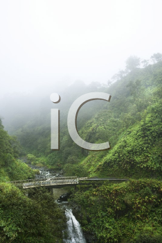 Royalty Free Photo of Mist Above a Waterfall on the Road to Hana, Hana Highway, Hawaii, USA