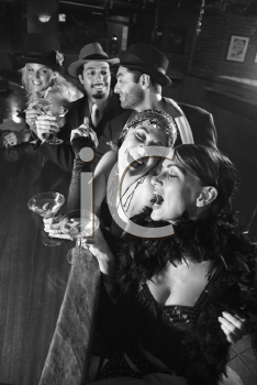 Royalty Free Photo of a Group of Males and Females Sitting at a Bar Laughing