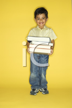 Royalty Free Photo of a Boy Holding a Stack of Books