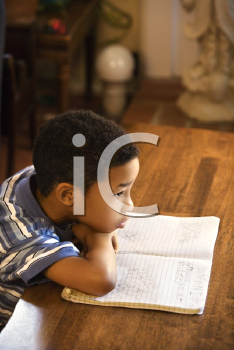 Royalty Free Photo of a Young Boy Looking at a Book