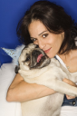 Royalty Free Photo of a Woman Holding a Pug