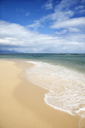 Royalty Free Photo of a Sandy Beach With Waves in Maui, Hawaii