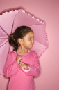 Royalty Free Photo of a Little Girl Holding an Umbrella