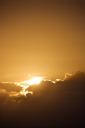 Royalty Free Photo of the Sun Peeking Through the Clouds