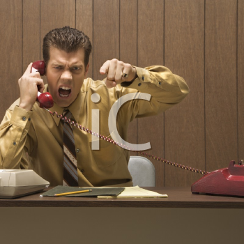 Royalty Free Photo of a Businessman Shouting into a Telephone
