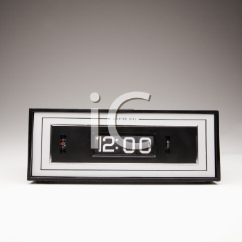 Royalty Free Photo of a Retro Alarm Clock Set For 12:00