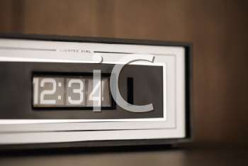 Royalty Free Photo of a Retro Alarm Clock Set for 12:34