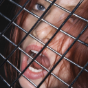 Royalty Free Photo of a Woman Behind a Fence With Her Mouth Open