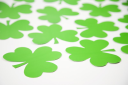 Royalty Free Photo of a Group of Green Paper Shamrocks
