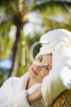 Royalty Free Photo of a Woman Wearing a Bathrobe and Towel