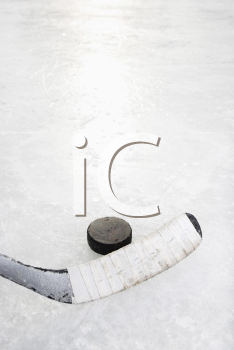 Royalty Free Photo of a Hockey Stick on an Ice Rink