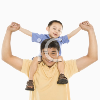 Royalty Free Photo of a Father Holding His Son on His Shoulders