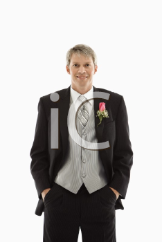 Royalty Free Photo of a Groom With Hands in Pockets