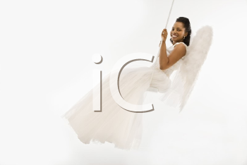 Royalty Free Photo of an Angelic African-American Bride Swinging