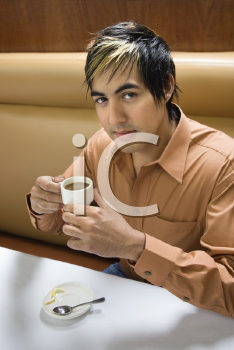 Royalty Free Photo of a Man Drinking Espresso