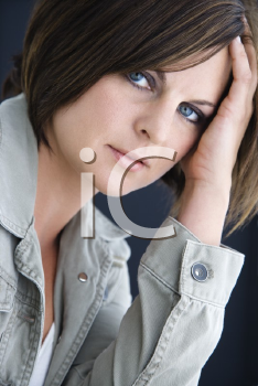 Royalty Free Photo of a Brunette Woman Resting Her Head on Her Hand