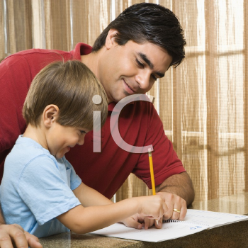 Royalty Free Photo of a Father Helping His Son with Homework