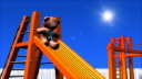 Royalty Free HD Video Clip of a Teddy Bear Going Down a Slide in a Playground