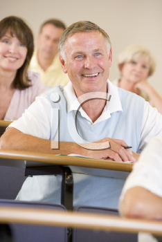 Royalty Free Photo of a Smiling Man in a Classroom