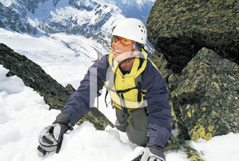 Royalty Free Photo of a Mountain Climber Looking Up