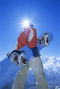 Royalty Free Photo of a Snowboarder Walking