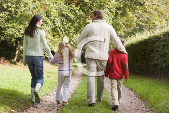 Royalty Free Photo of Back View of a Family Walking Outside