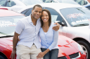 Royalty Free Photo of a Young Couple Buying a Car