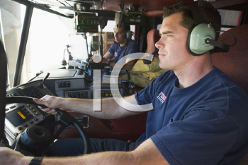Royalty Free Photo of Two Firefighters in a Truck
