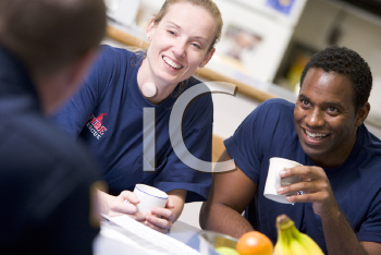 Royalty Free Photo of Firefighters in the Break Room