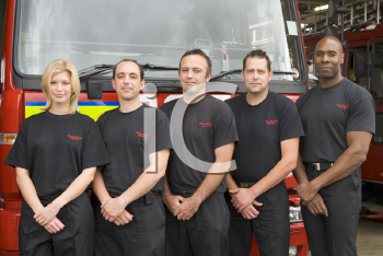 Royalty Free Photo of Firefighters in Front of a Truck