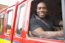 Royalty Free Photo of a Firefighter in the Truck