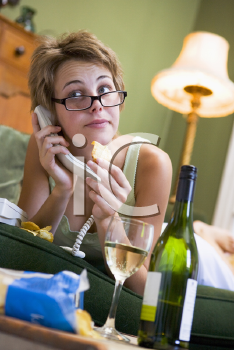 Royalty Free Photo of a Young Woman Talking on a Phone and Drinking Wine