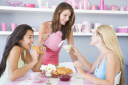 Royalty Free Photo of Women Having Tea and a Snack
