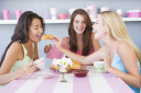 Royalty Free Photo of Three Women Having Tea