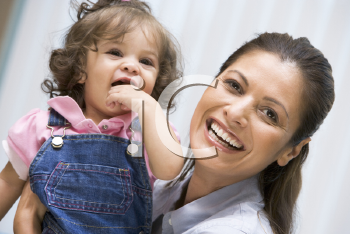 Royalty Free Photo of a Woman Holding a Girl