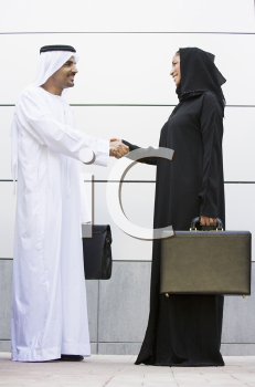Royalty Free Photo of Two Arabian Businesspeople Shaking Hands