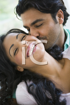 Royalty Free Photo of a Couple Being Affectionate