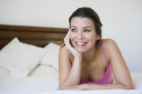 Royalty Free Photo of a Woman Resting on Her Bed