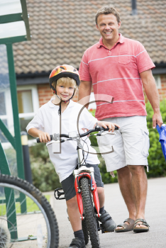 Royalty Free Photo of a Father and Son on a Bike