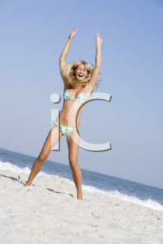 Royalty Free Photo of a Happy Woman on the Beach