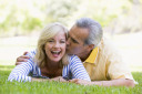Royalty Free Photo of a Couple on the Grass