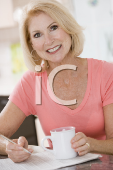 Royalty Free Photo of a Woman Drinking Coffee