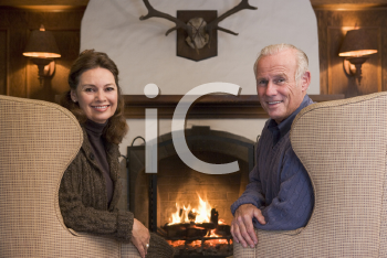 Royalty Free Photo of a Couple Beside the Fire
