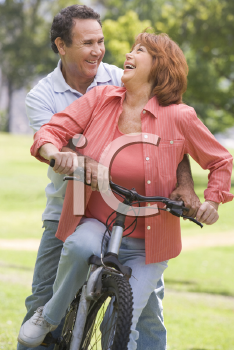Royalty Free Photo of a Couple on a Bike