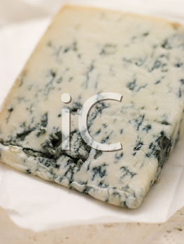 Royalty Free Photo of a Wedge of Leicestershire Stilton Cheese