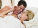 Royalty Free Photo of a Couple Lying in Bed