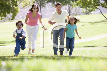 Royalty Free Photo of a Happy Family Running
